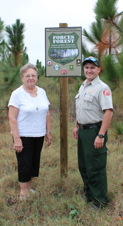 Ranger and FORCES landowner stand on tract of land