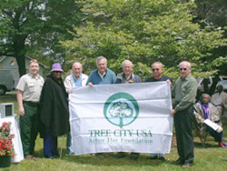 Tree City USA winners with banner