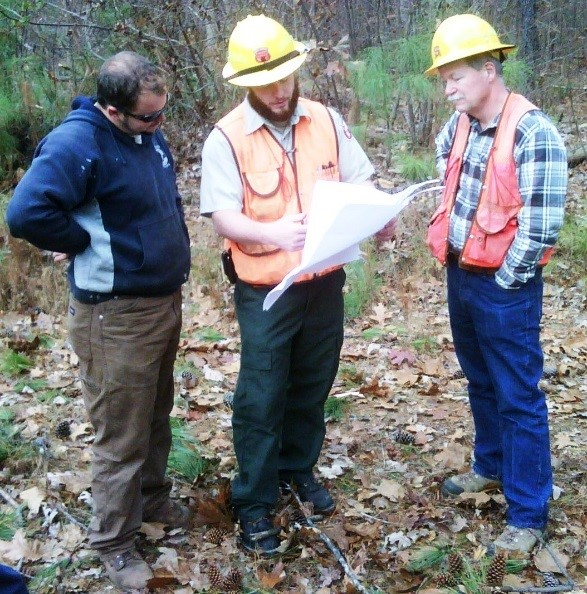 Forest Service Staff discussing results of Inspection with loggers and timber buyers